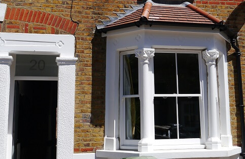 Outside image of Sash window and front door.