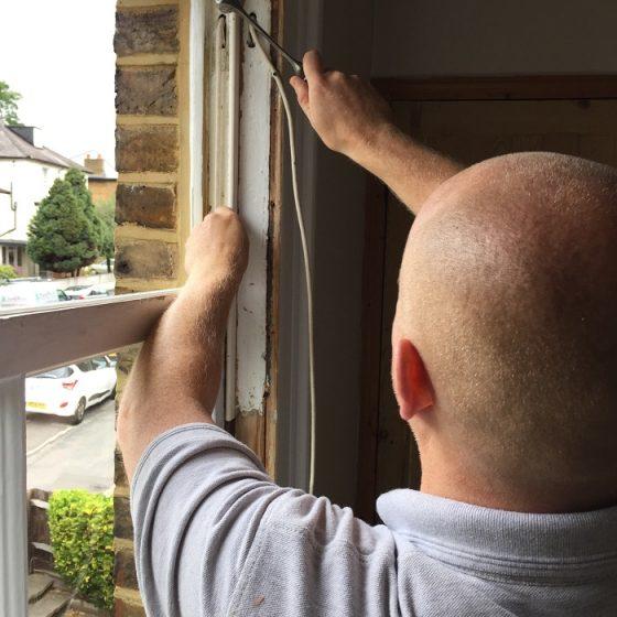 Man servicing window frames.
