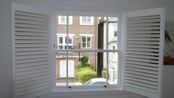 Shutters fully open on a window.