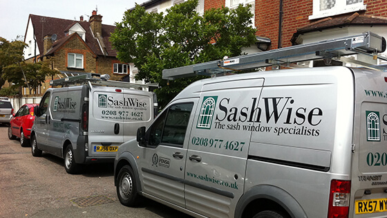 Sashwise vans parked outside of a house