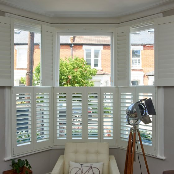 Sash windows inside the home with shutters