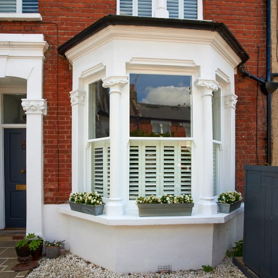 Outside shot of a sash window and shutters